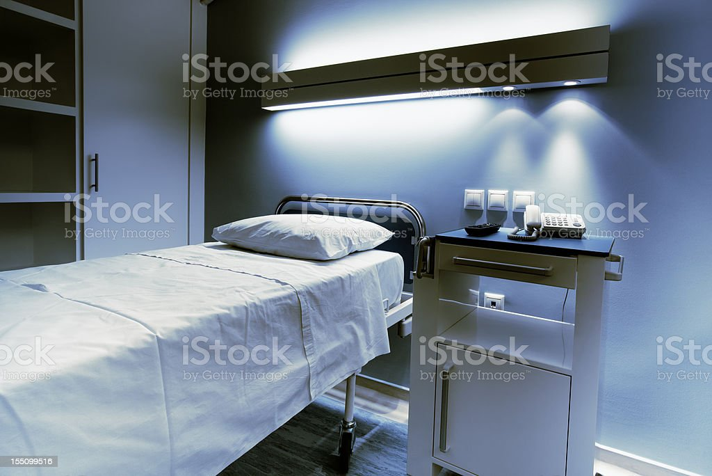 Hospital bed at night stock photo