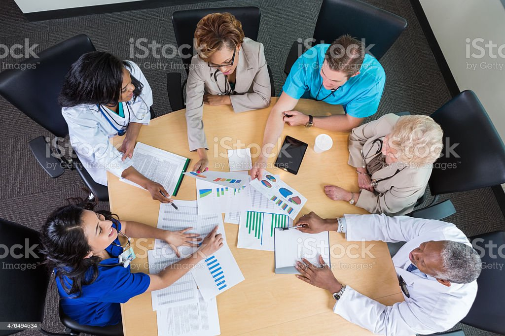 Hospital board members meeting to discuss financial issues and policies stock photo