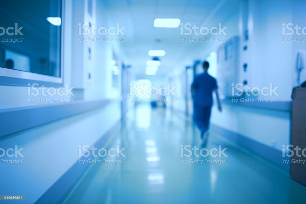 Hospital corridor and doctor as a blurred defocused background stock photo