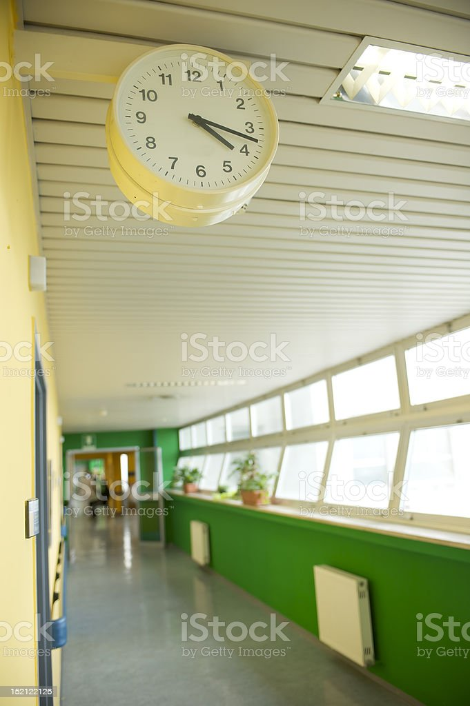 hospital corridor with watch, focus on foreground royalty-free stock photo