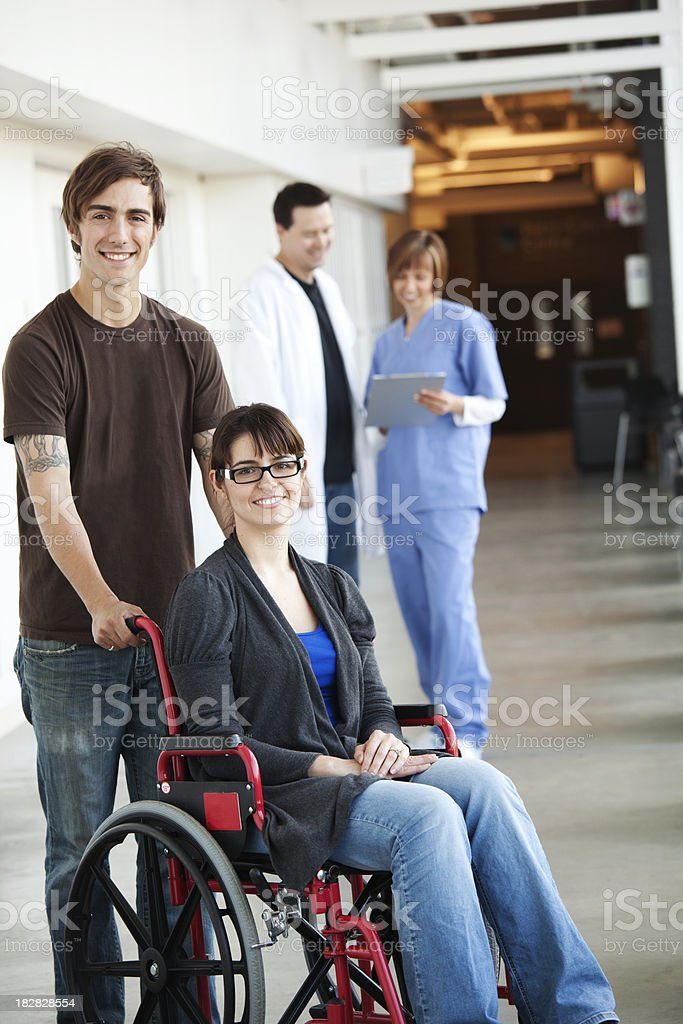 Hospital - Couple with wheelchair royalty-free stock photo