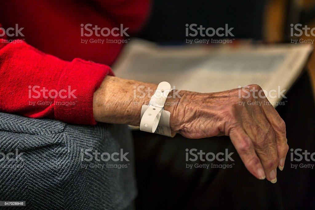 Hospital Emergency Room Elderly Woman Patient Identification Bracelet Wrist Band stock photo