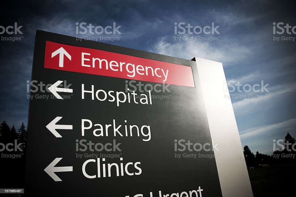 Hospital emergency sign in dramatic light