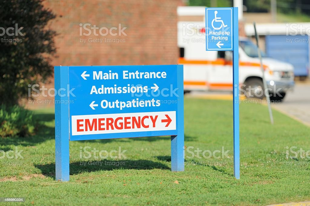 Hospital entrance and emergency sign with ambulance stock photo