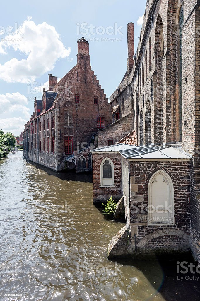 Hospital of Saint John and canal in Bruges, Belgium stock photo