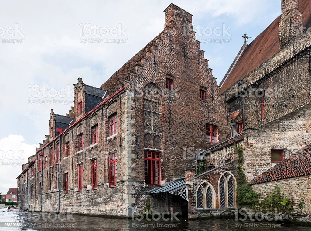 Hospital of Saint John with canal in Bruges, Belgium stock photo