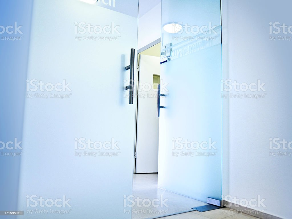 Hospital- open glass doors to the Operation area stock photo