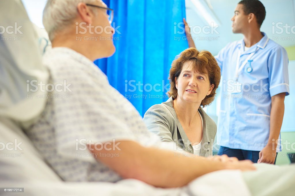 hospital patient and loving wife stock photo