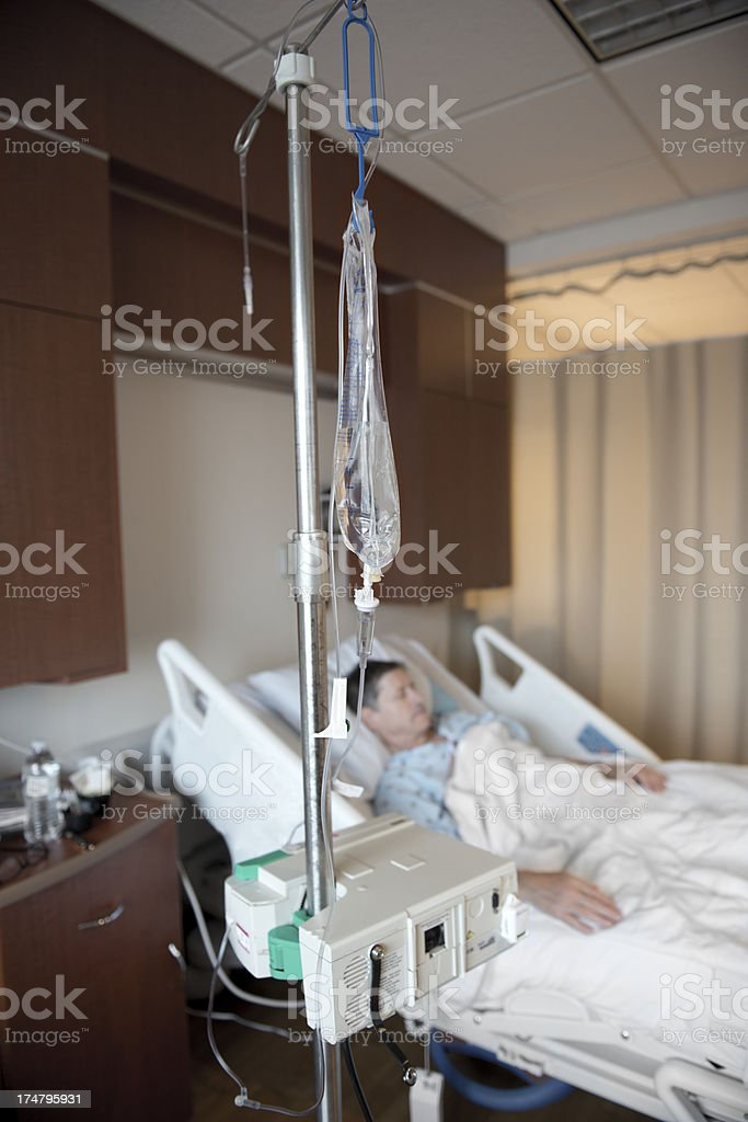 Hospital Patient in Bed With IV stock photo