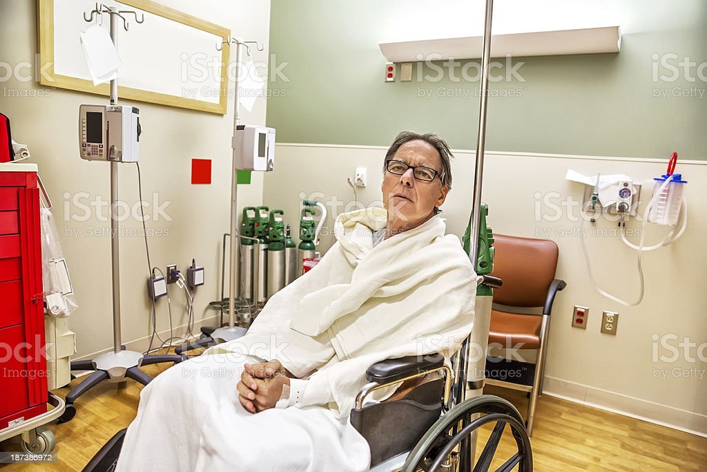 Hospital patient is sitting in a wheel chair royalty-free stock photo