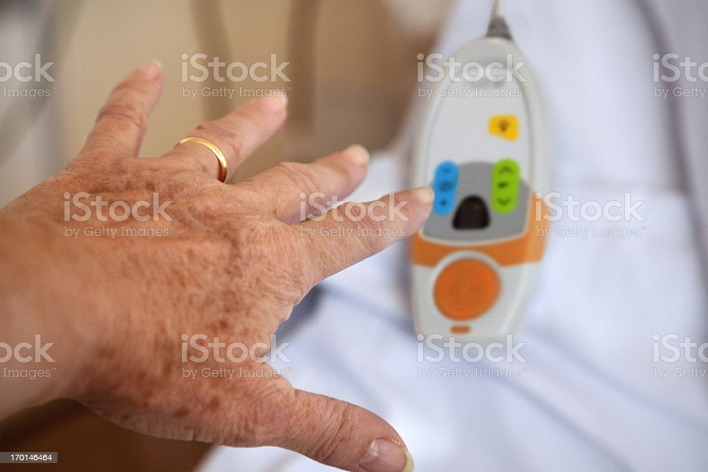 Hospital:  patient trying to reach call button stock photo