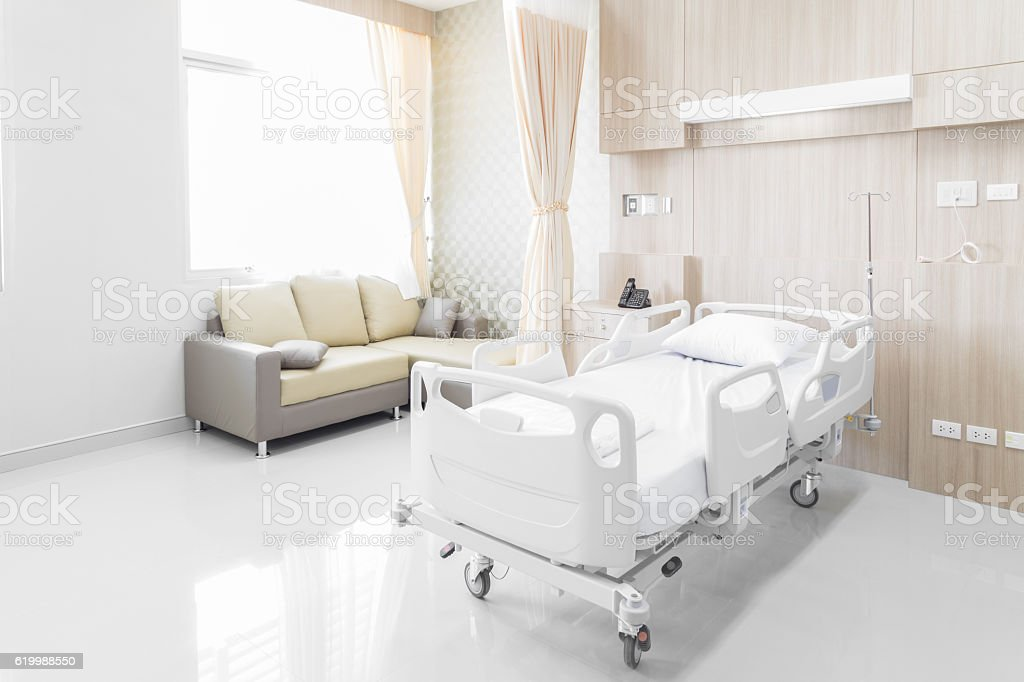 Hospital room with beds and comfortable medical equipped stock photo
