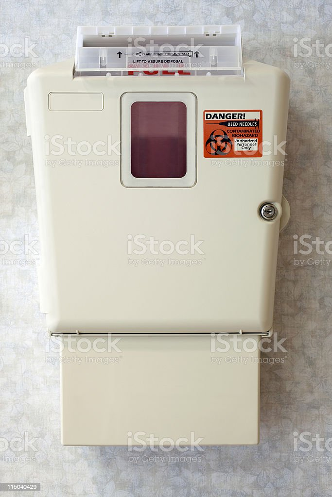Hospital Sharps Syringe Needle Disposal Container on a Wall stock photo