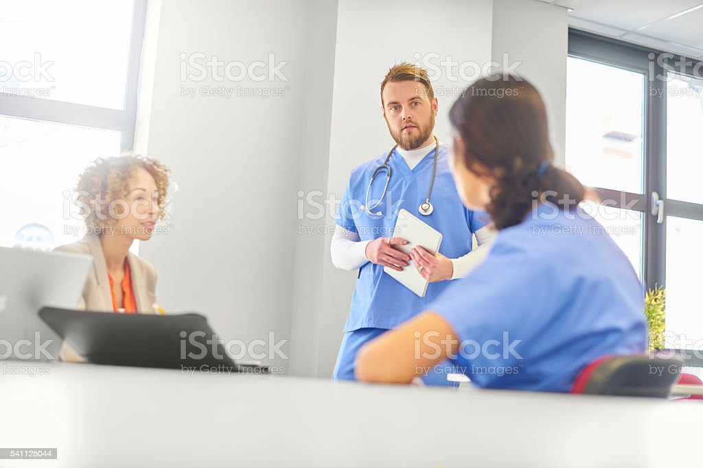hospital staff meeting stock photo