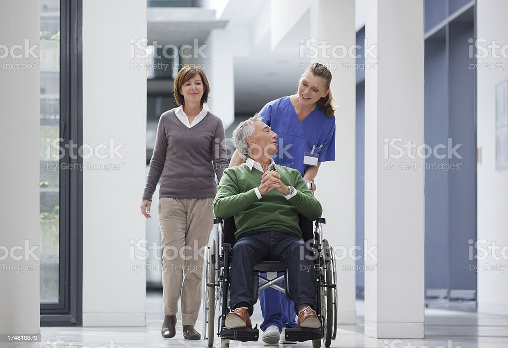 Hospital Staff member with patient stock photo