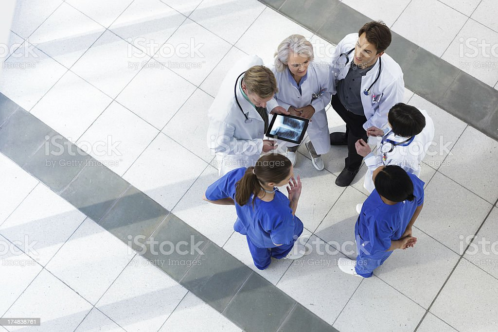 Hospital staff talking about patient care stock photo
