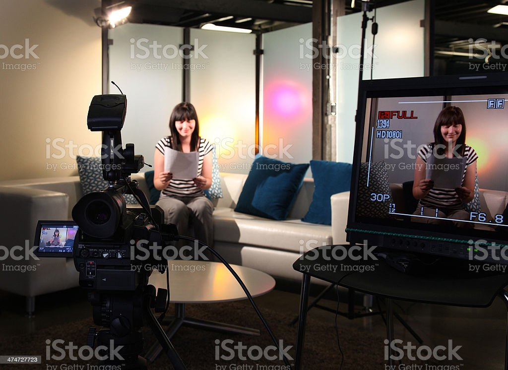TV Host Looking Over Notes stock photo