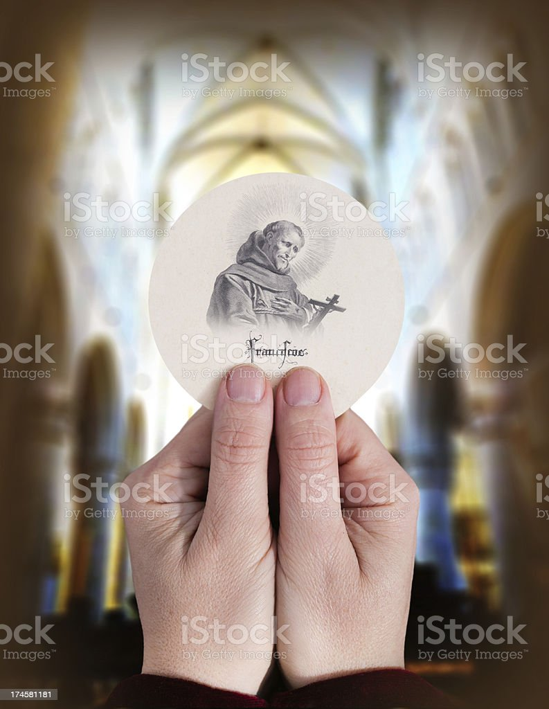 Host with 17th century picture of St. Franciscus stock photo