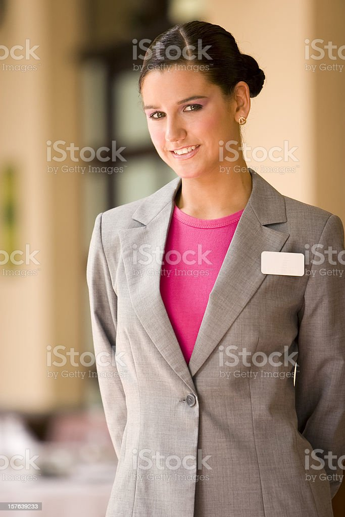 A hostess in grey jacket and pink blouse stock photo