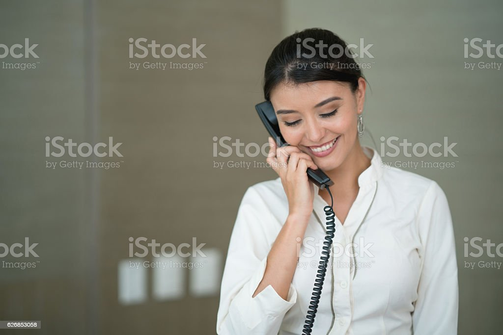 Hostess on the phone at the hotel stock photo