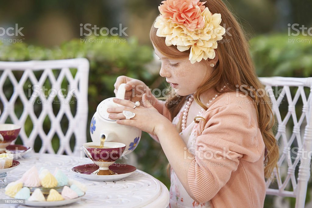 Hosting a tea party royalty-free stock photo