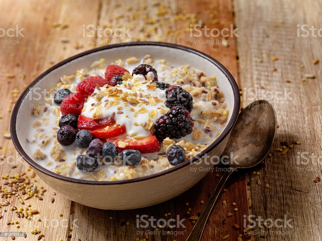 Hot 7 Grain Breakfast Cereal With Yogurt and Fresh Fruit stock photo