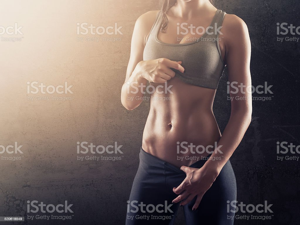 Hot abs of young fit woman stock photo