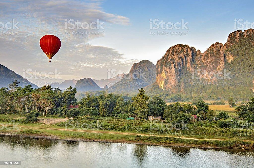 Hot air balloon at sunrise, Vang Vieng Laos stock photo