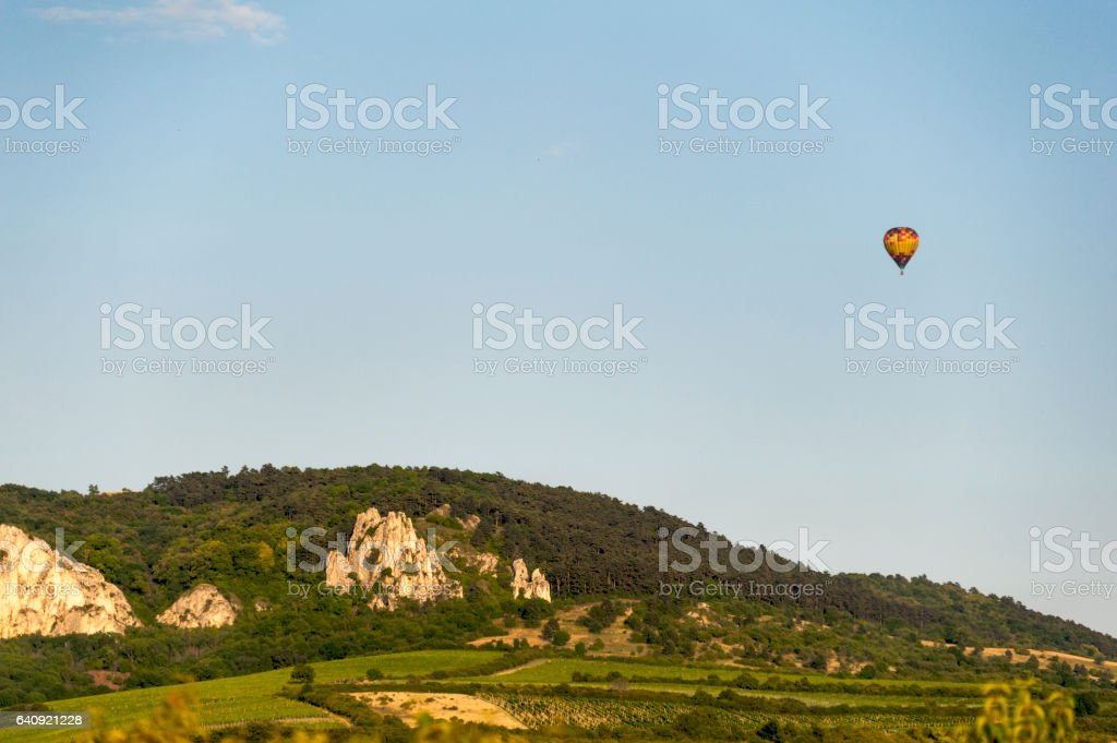 Hot air balloon floating over mountains and winery in South Moravia stock photo