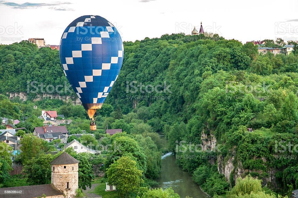Hot air balloon fly over canyon stock photo