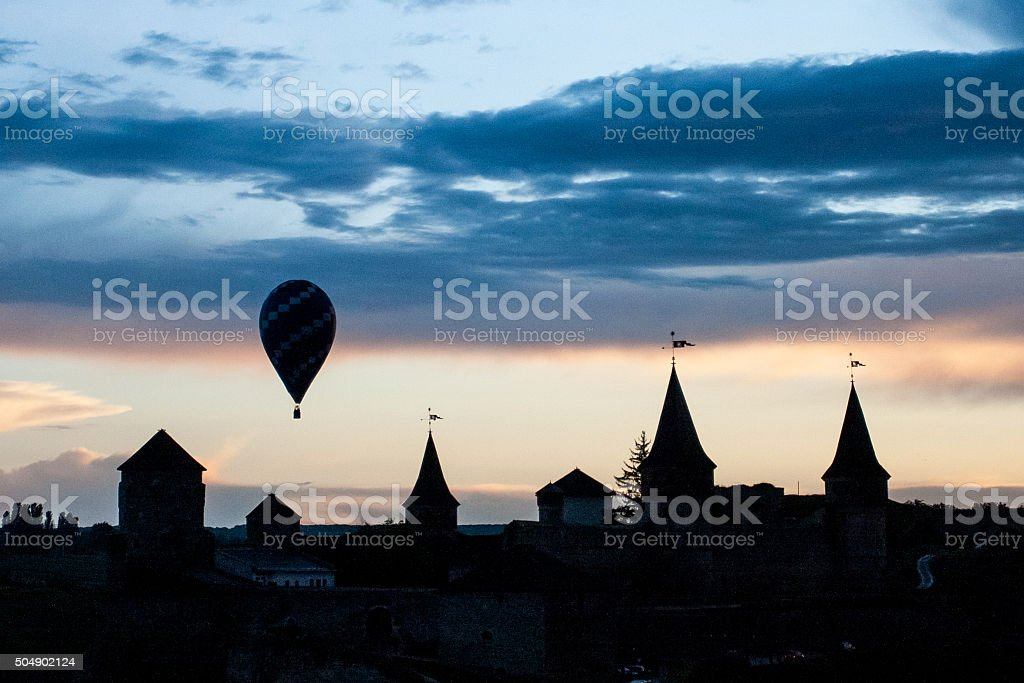 Hot air balloon fly over Kamyanets-Podilsky castle stock photo