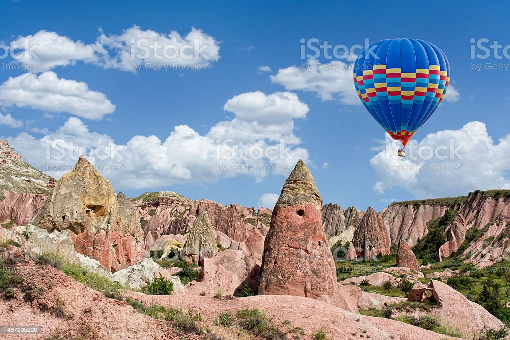 Hot air balloon flying over Red valley at Cappadocia, Turkey stock photo