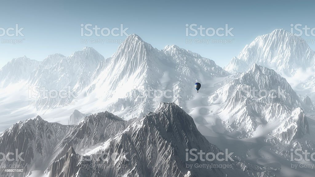 Hot air balloon flying over winter mountain landscape. stock photo