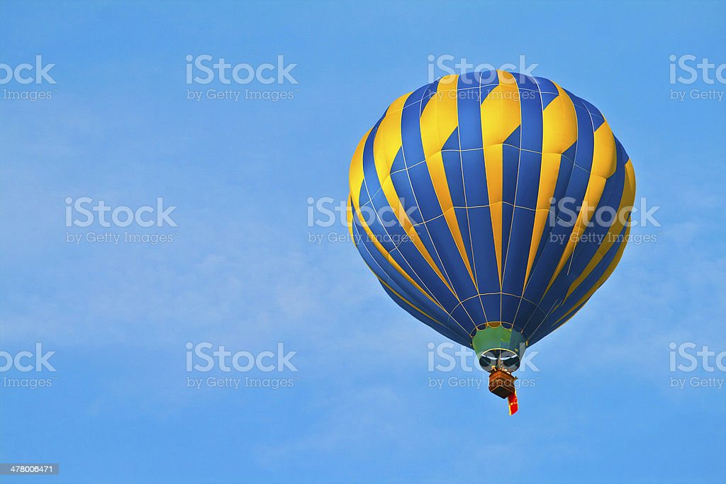 Hot Air Balloon in cloudy sky royalty-free stock photo