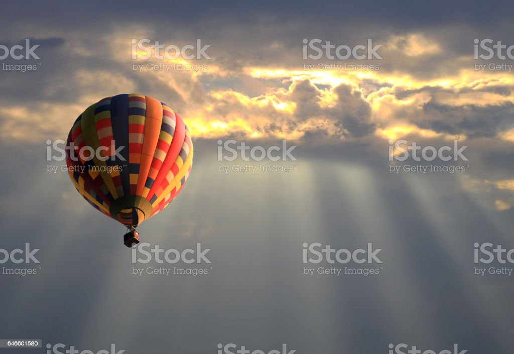 Hot air balloon in the sunset sky stock photo