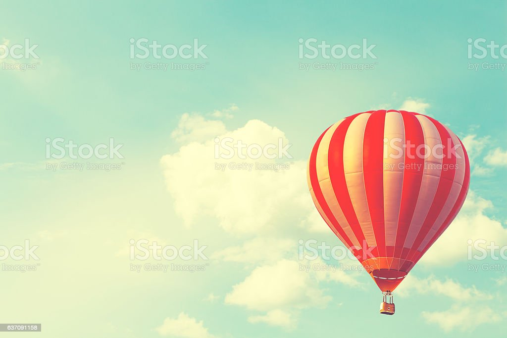 Hot air balloon on sun sky with cloud, vintage and stock photo