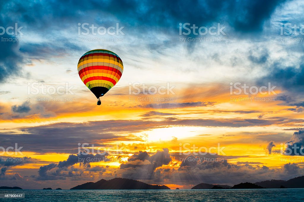Hot air balloon over the sea at Sunset stock photo