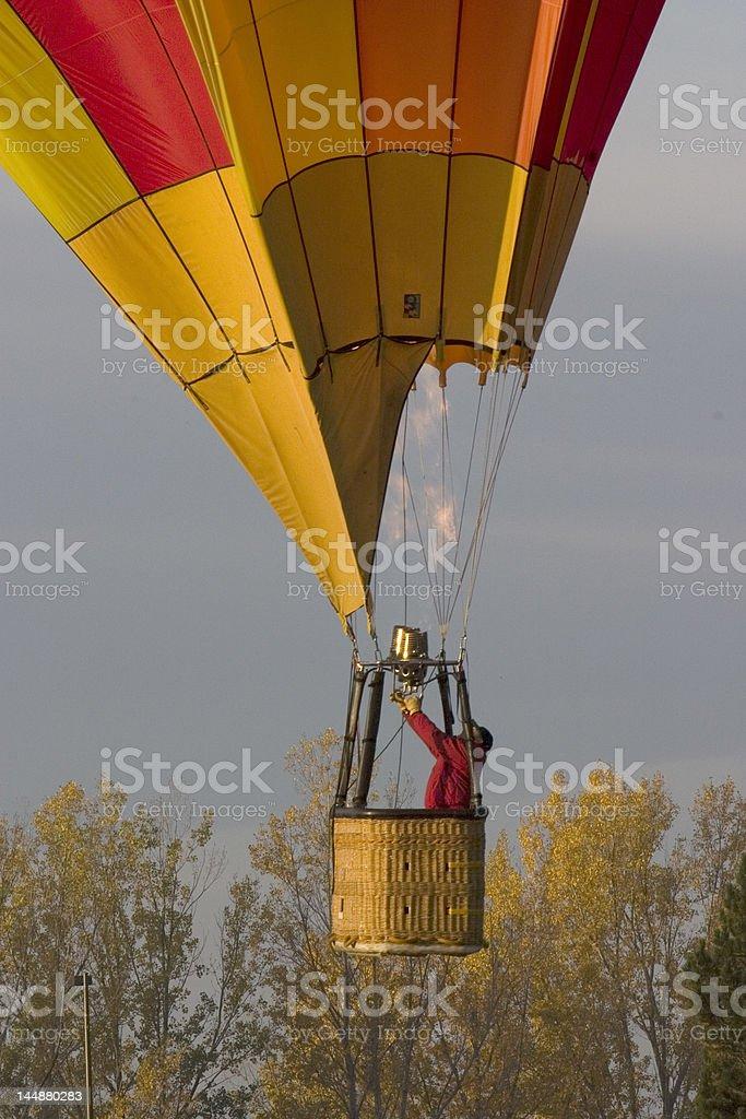 hot air balloon, solo pilot stock photo