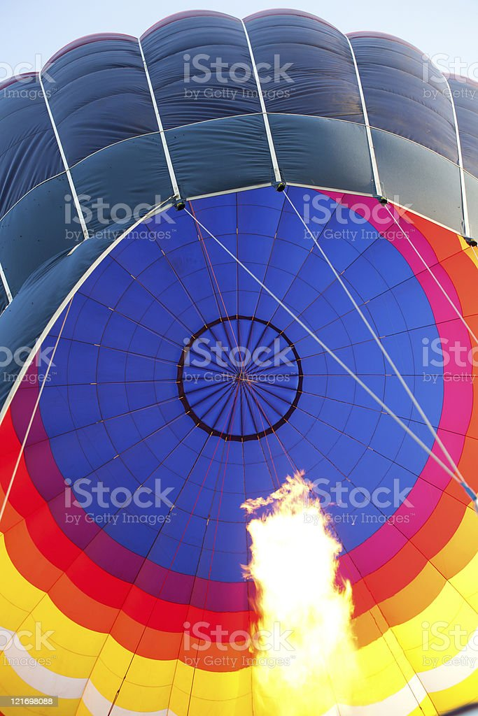 Hot air balloon with burning flame stock photo