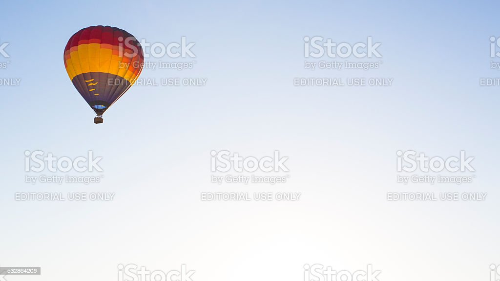 Hot Air Balloon With Gay Pride Rainbow Floats in Sky stock photo