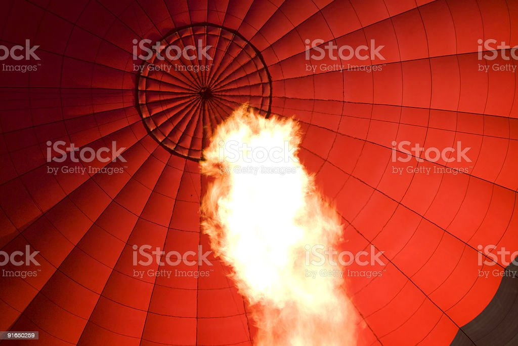 Hot air balloon with huge flame in foreground royalty-free stock photo