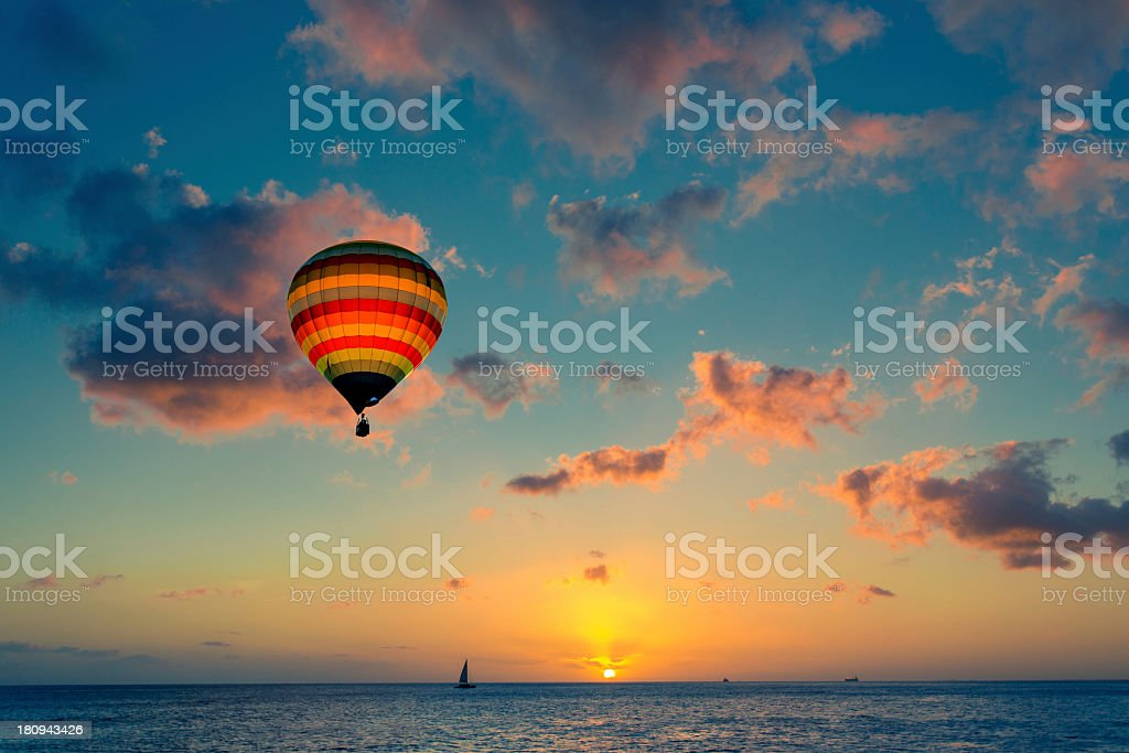 Hot air balloon with sunset at the sea background royalty-free stock photo