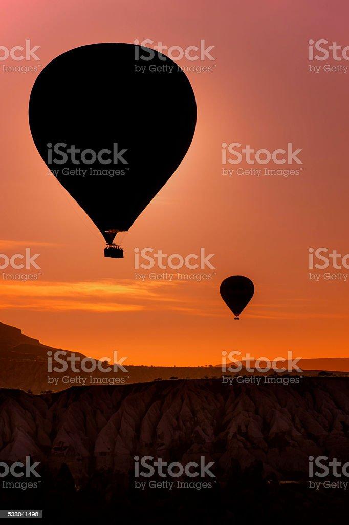 Hot air balloons at dawn stock photo