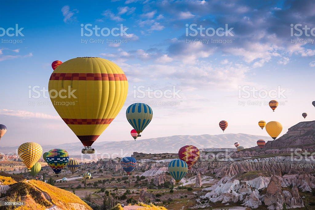 Hot air balloons fly over Cappadocia stock photo