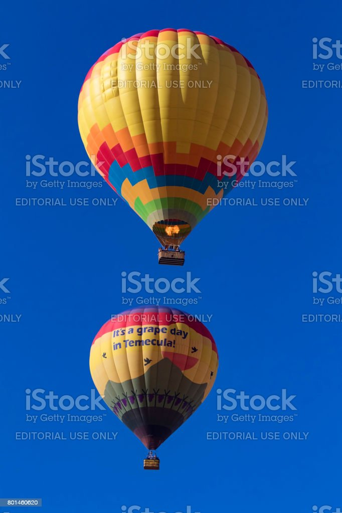 Hot air balloons flying over festival stock photo