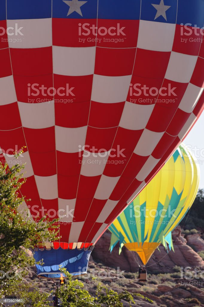 Hot Air Balloons Hover Red Rock Canyon stock photo