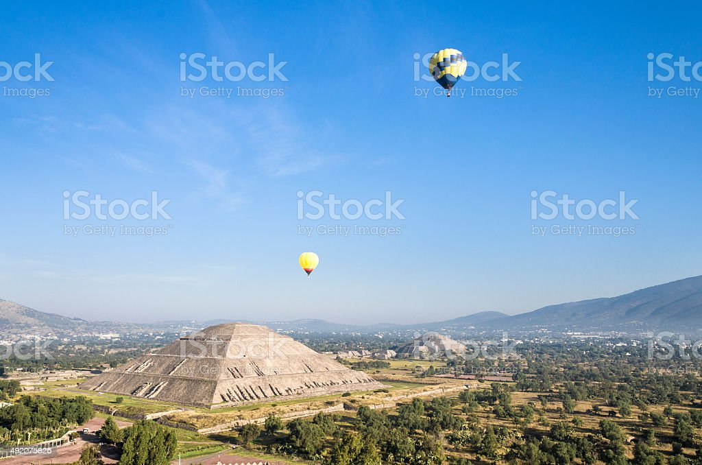 Hot air balloons in the Sun and Moon Pyramids stock photo