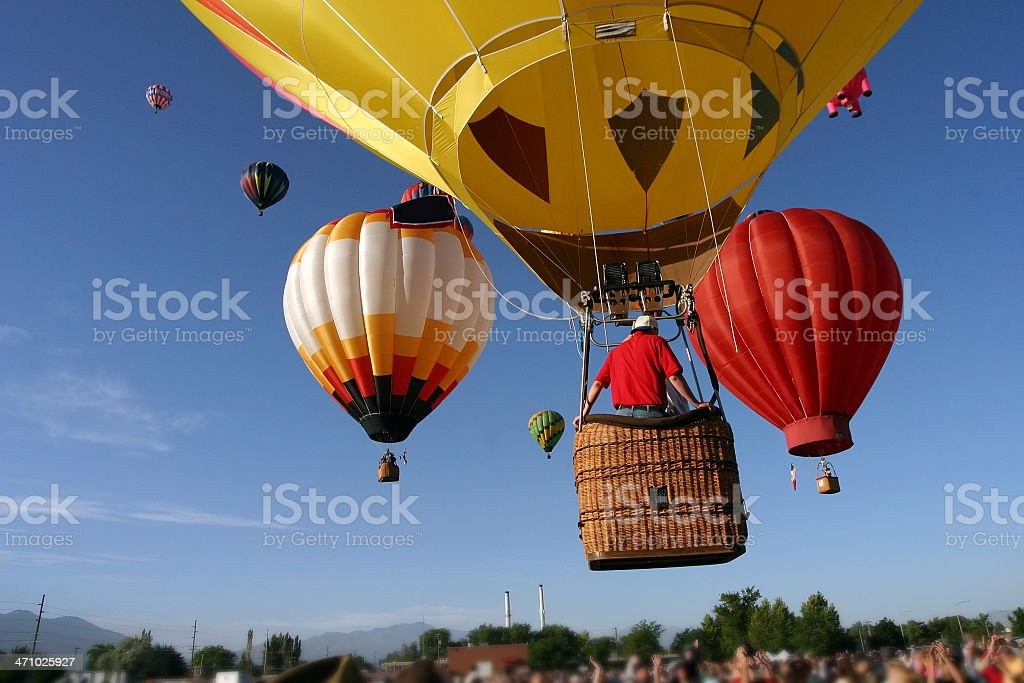 Hot Air Balloons over crowd stock photo