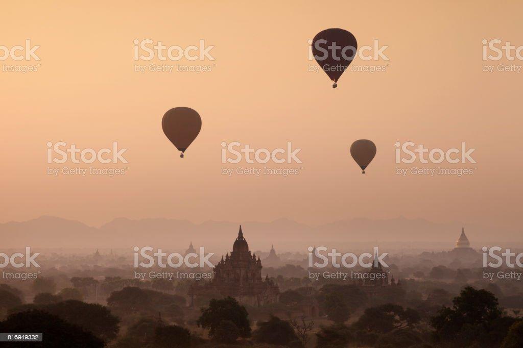 Hot Air Balloons Over Htilominlo Temple stock photo