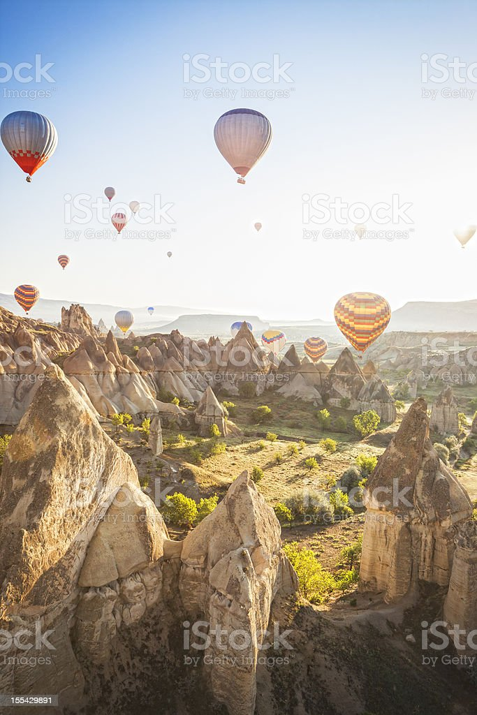 Hot air ballons over Love Valley near Goreme and Nevsehir in the...